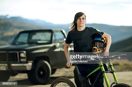 Woman with her mounain bike and truck.