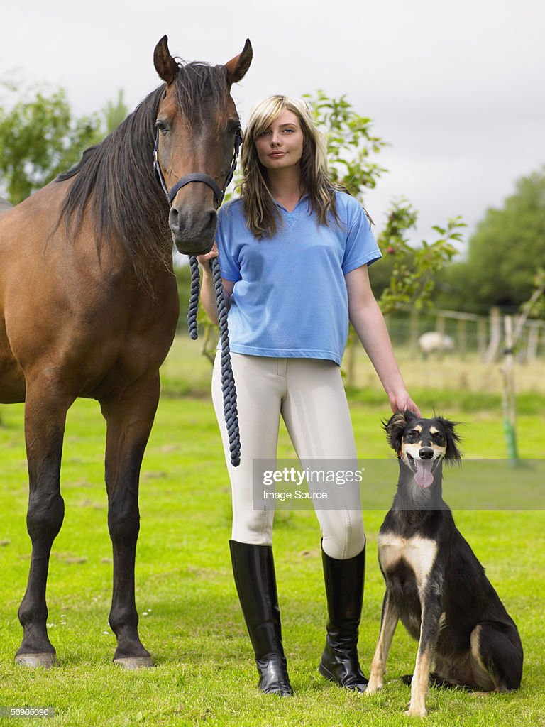 Woman with horse and dog : Stock Photo