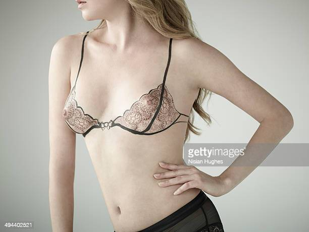 Woman with illustration of her bra over breasts
