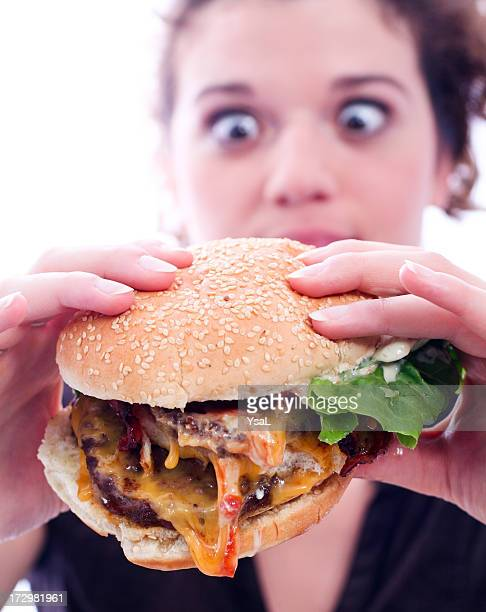 Woman with juicy burger
