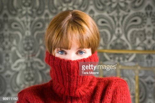 woman with jumper pulled over face