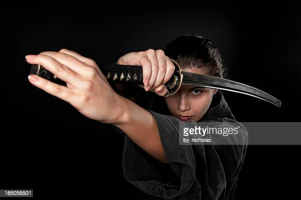 Woman with katana, black background