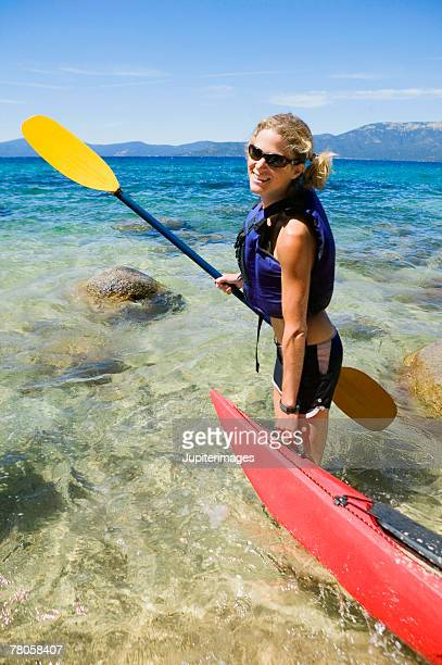 Woman with kayak and paddle