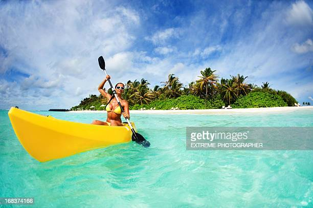 Woman With Kayak In Front Of Maldivian Island