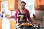 Woman with learning disability cooking in the kitchen