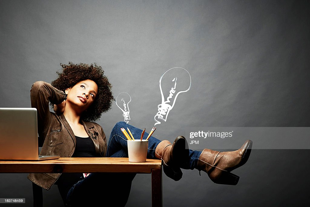 Woman with legs on table searching for ideas