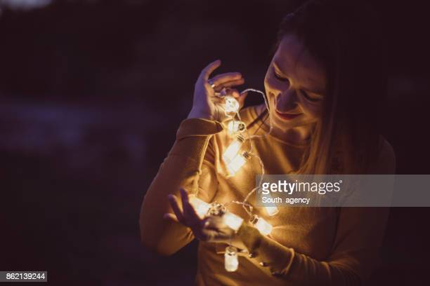 Woman with light bulbs