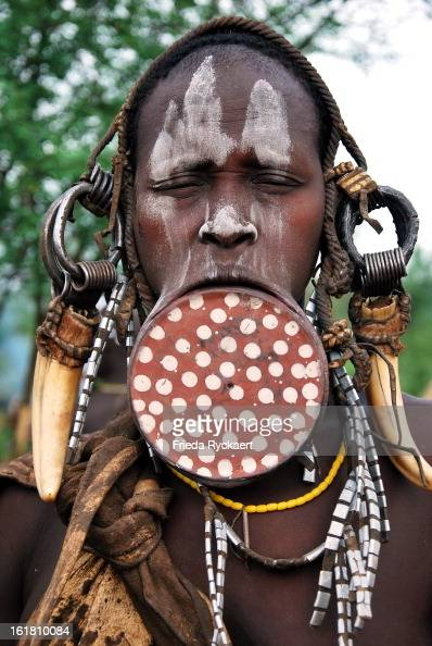 CONTENT] Woman with lip plate of the Mursi tribe living at the Omo river's western bank in southEthiopa