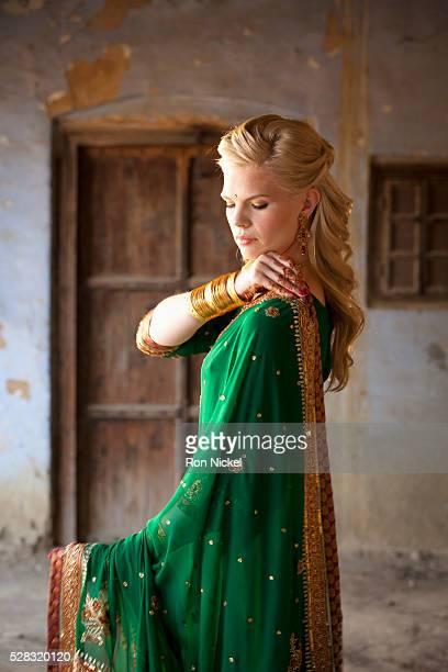 A woman with long blond hair wearing a sari; ludhiana punjab india