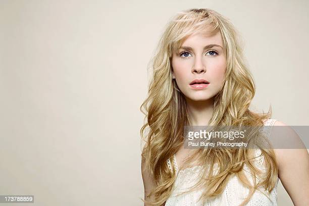 Woman with long blonde hair.