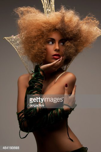 woman with long curly hair in crown : Stock Photo
