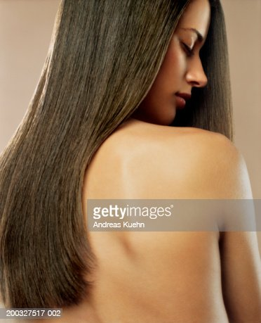 Woman with long hair and eyes closed : Stock Photo