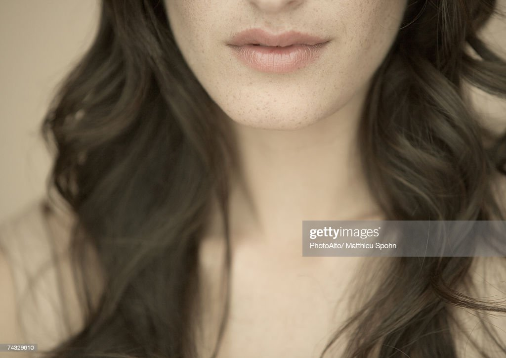 Woman with long hair, close-up of lower face and neck : Stock Photo
