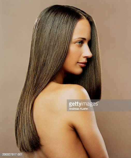 Woman with long hair looking away