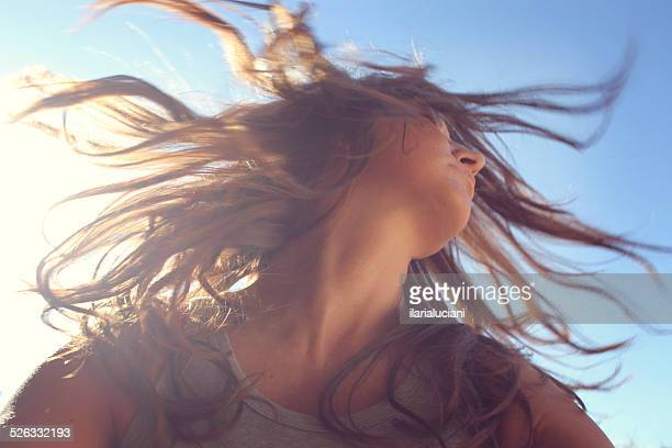 Woman with long hair shaking her head