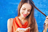 Beautiful caucasian woman in red t-shirt with white powder in her palm