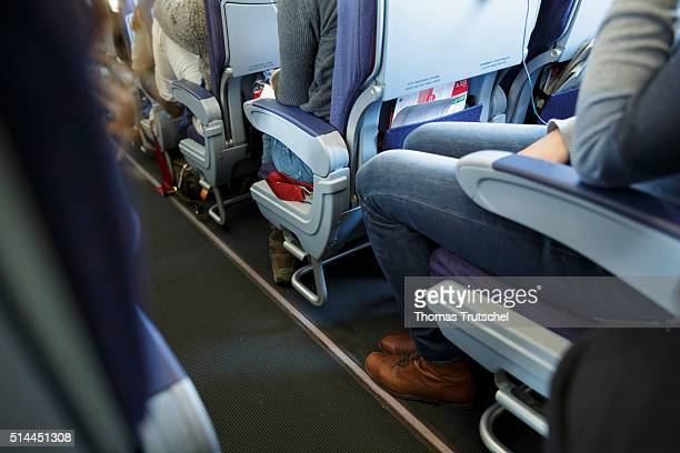 New York United Sates of America February 23 A woman with long legs sitting on her seat in economy class in an aircraft on February 23 2016 in Berlin...