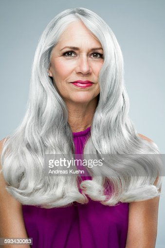 Woman With Long Shiny Gray Hair Portrait Stock Photo