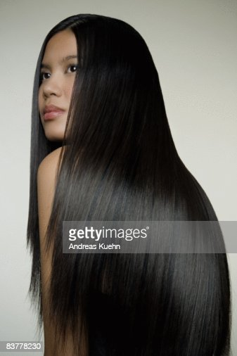 Woman with long shiny hair, profile.