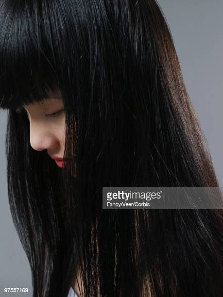 Woman with long, shiny, straight hair