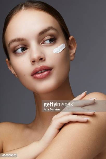 Woman with lotion on face
