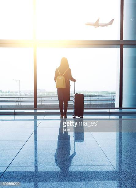 Woman with luggage waiting in the airport