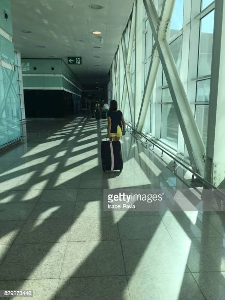 Woman with luggage walking at airport
