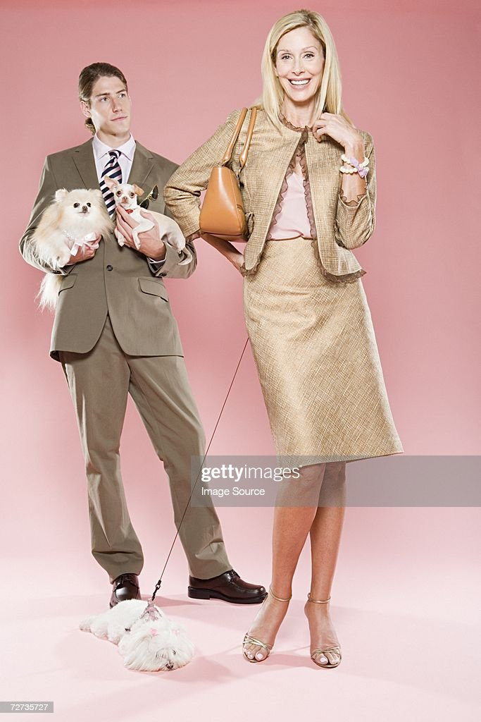 Woman with man and dogs : Stock Photo