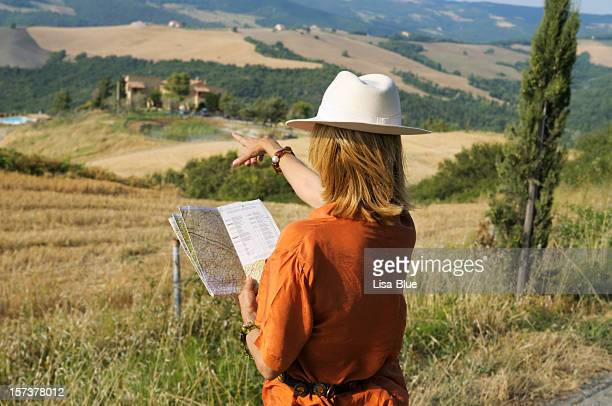 Woman with Map Looking for Country Inn