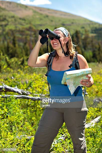 Woman with Map uses Binoculars