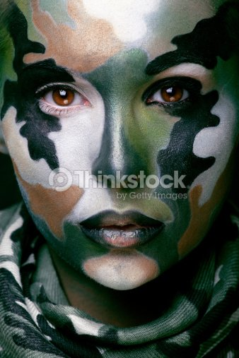 Woman With Military Style Clothing And Face Paint Makeup
