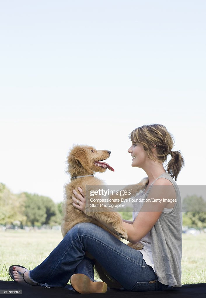 woman with mini golden doodle