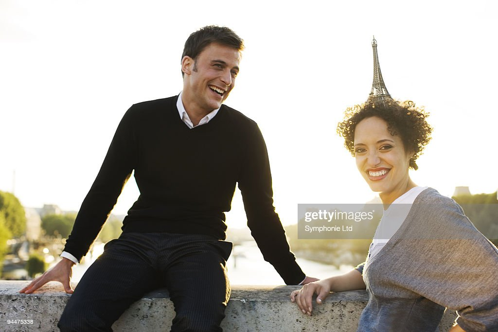 Woman with miniature Eiffel Tower on head : Stock Photo