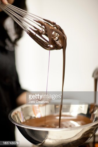 Woman with mixing bowl and melted chocolate