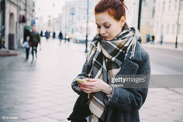 Woman with mobile phone on the street