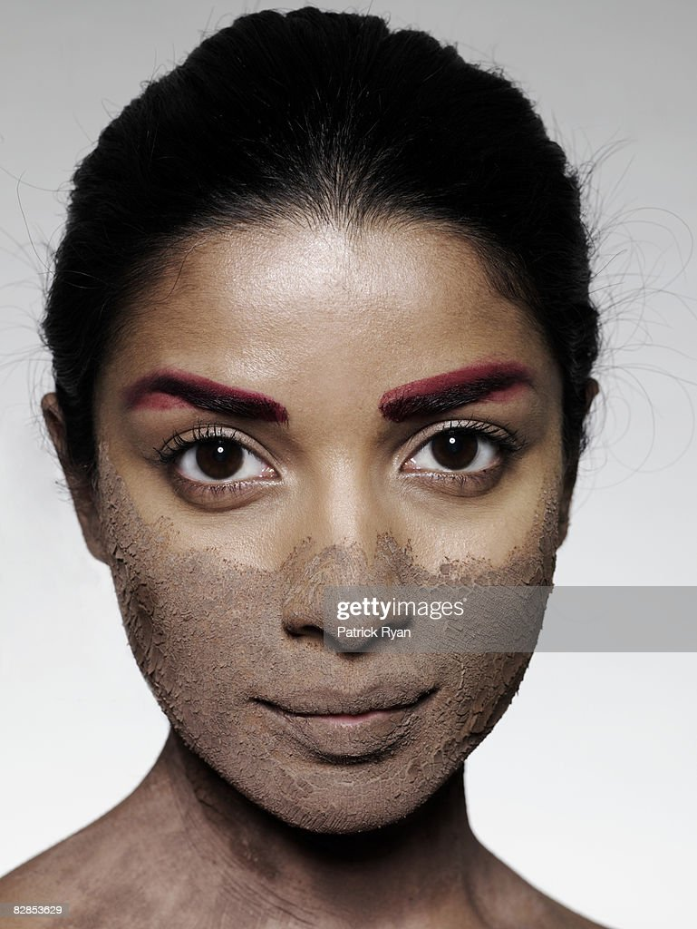 Woman with mud mask : Stock Photo