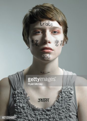 woman with multi-languages of 'sad' on her : Stock Photo