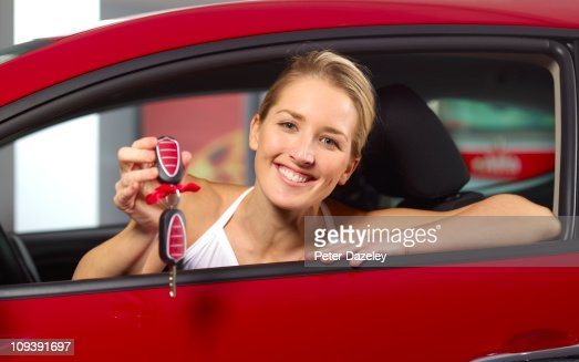 Woman with new car/present : Foto stock