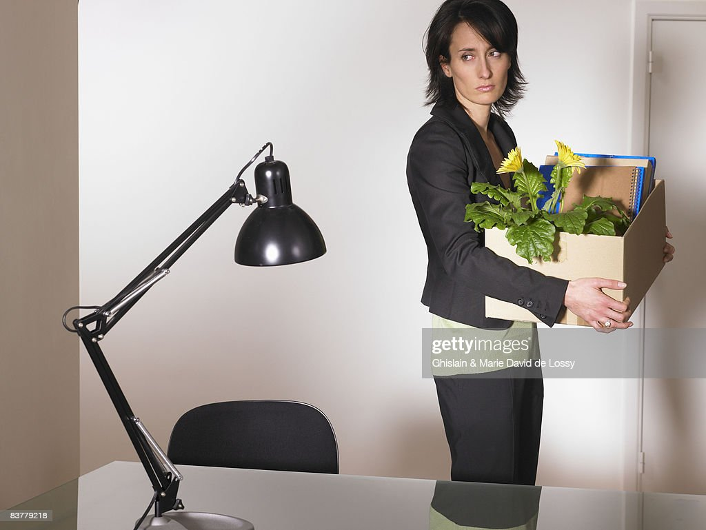 Woman with office furniture in a box