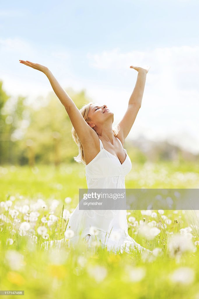 Woman with open hands relaxing on a sun day. : ストックフォト