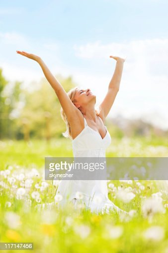 Woman with open hands relaxing on a sun day. : Stock Photo