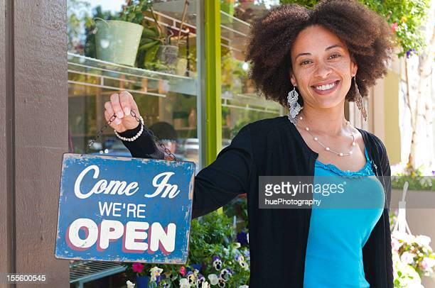 Woman with Open Sign