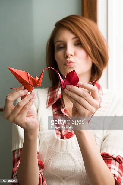 Femme avec origami