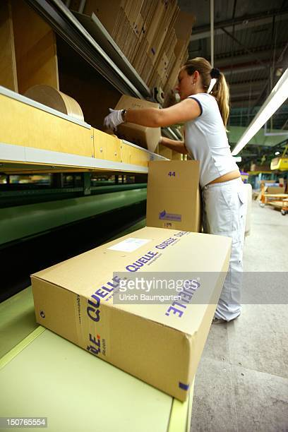 Woman with packaging material in the Quelle mail order center