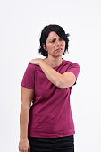 woman with pain on shoulder on white background