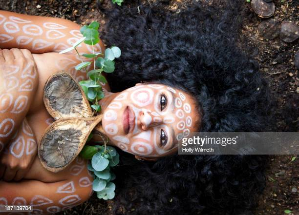 Woman with painted body and necklace of flowers, Lago Izabal, Guatemala