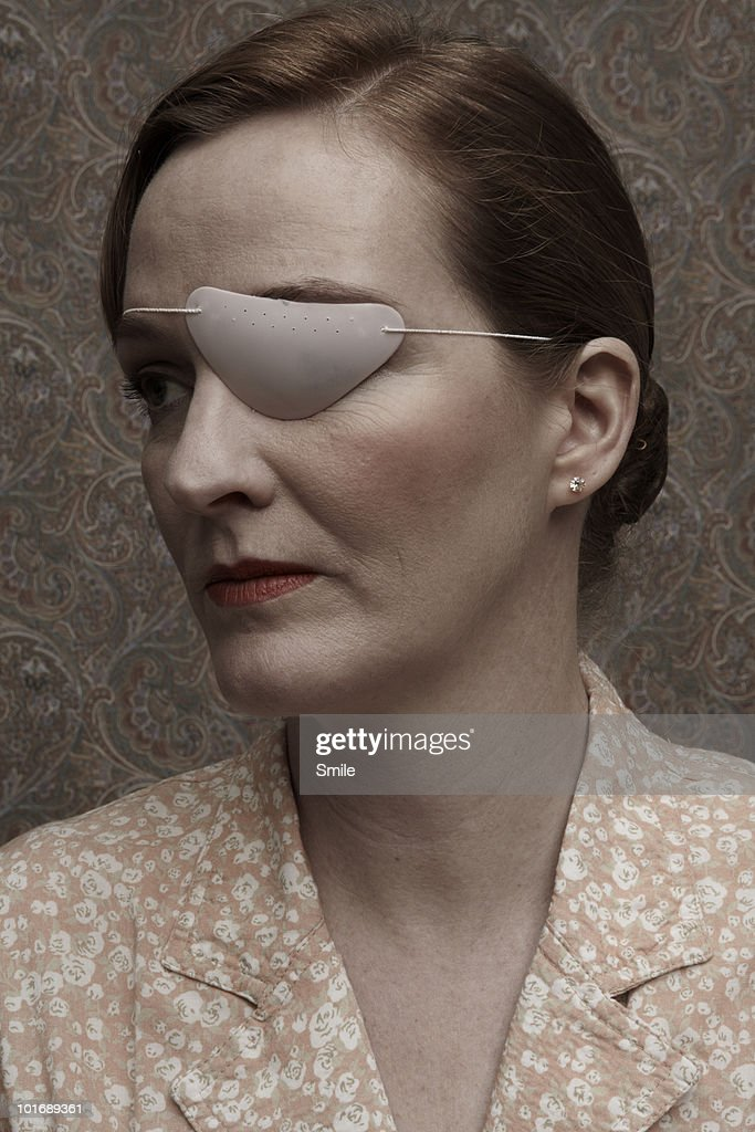 Woman with patch over her eye : Stock Photo