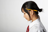 Woman with pencil behind ear, side view