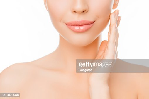 woman with perfect skin applying cream on face : Foto stock