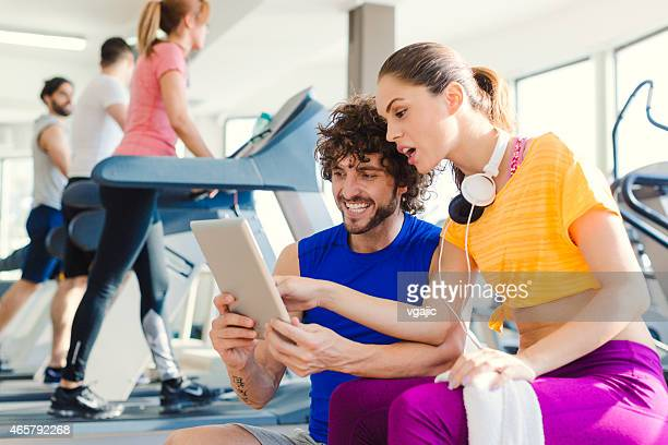 Woman with personal trainer in the gym.